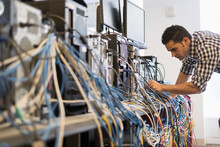 Tangled Cables With Young Technician Man In Background
