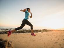 USA, California, Newport Beach, Woman Jogging On Beach
