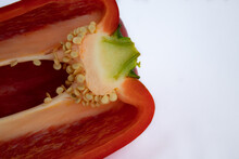 Red Chili Cut In Half, Showing Seeds On White Background