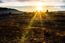 Sun Rises Between Rock Spires In The Desert