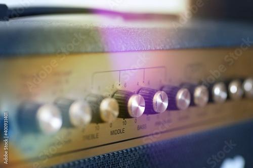 Fotografija guitar amp potentiometers with unfocused background