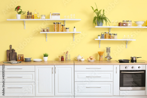 Photographie Interior of modern kitchen with shelves