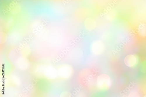Fototapeta Soft colorful spring blurred background,glowing natural Easter holiday wallpaper.Abstract green blue yellow bokeh. obraz