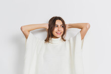 Resting. Portrait Of Beautiful Brunette Woman In Comfortable Soft Longsleeve Isolated On White Studio Background. Home Comfort, Emotions, Facial Expression, Winter Mood Concept. Copyspace.