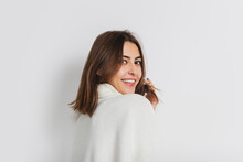 Smiling. Portrait Of Beautiful Brunette Woman In Comfortable Soft Longsleeve Isolated On White Studio Background. Home Comfort, Emotions, Facial Expression, Winter Mood Concept. Copyspace.