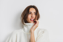 Cozy. Portrait Of Beautiful Brunette Woman In Comfortable Soft Longsleeve Isolated On White Studio Background. Home Comfort, Emotions, Facial Expression, Winter Mood Concept. Copyspace.