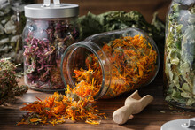 Glass Jar Of Dry Calendula Flowers For Making Herbal Tea, Jars Of Various Healthy Herbs - Coneflowers, Linden Tree Blossom, Raspberry And Currant Leaves, Bunch Of Heather. Alternative Medicine.