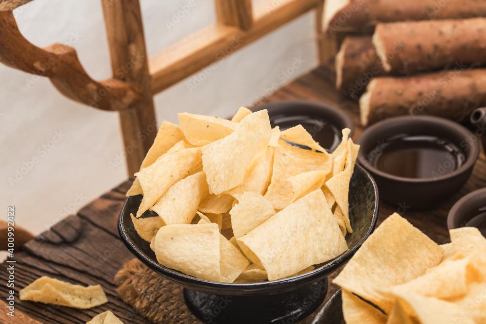 Fototapeta A plate of fried crispy yam slices,