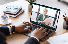 Unrecognizable Black Businessman Having Videocall With Business Partner, Using Laptop