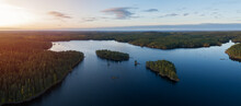Aerial View Of Of Small Islands On A Blue Lake Haukkajarvi In Helvetinjarvi National Park. Blue Lake, Islands And Green Forests From Above On A Summer Evening.