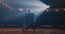 Senior Actor On Wheelchair Leaving Stage