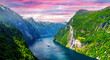 Panorama of breathtaking view of Sunnylvsfjorden fjord and famous Seven Sisters waterfalls, near Geiranger village in western Norway. Landscape photography