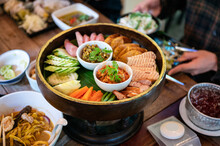 Set Appetizer Of Northern Thai Food With Fried Pork, Sausage, Vegetables And Thai Chili Sauce Dip On Khantoke Or Traditional Container