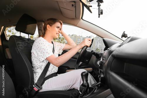 Stressed woman driving modern car