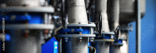 Fototapeta Large industrial water treatment and boiler room. Piping, flanges, butterlfy valves, rusty and corroded bolts. Industry, technology, special equipment, chemistry, heating, work safety. Panoramic view obraz