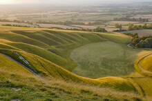 Curved Grasslands Seen From Above At Sunset From White Horse Hill Uffington