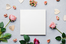Valentine Day Concept. Blank Canvas Board For Romantic Message. Mockup Poster, Hearts And Flowers On Grey Backdrop.