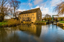 A View Toward An Old Mill On The River Nene At Oundle, UK On A Bright Sunny Day