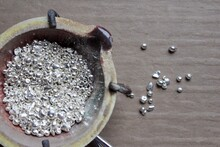 A Ceramic Crucible Or Melting Pot With Grains Of Sterling Silver 925 For Jewelry Making After Hand Smelting In A Workshop. One Of The Two Major Precious Metals On The Market.