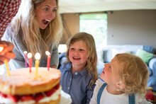 Happy Mother And Daughters Celebrating Birthday With Cake And Candles
