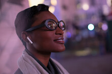 Close Up Young Woman In Eyeglasses On City Street At Night