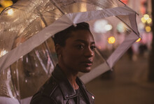 Beautiful Young Woman With Umbrella At Night