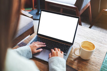 Mockup Image Of A Woman Using And Typing On Laptop Computer Keyboard With Blank White Desktop Screen
