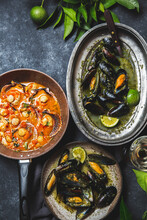 Mussels In Green Herb And White Wine Sauce And Scallops In Tomato White Wine Sause