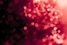 Red Light Glowing Defocused Holiday Blurr Bokeh In Black