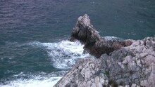 Fur Seal And Strong Wave Hit The Rock Formation