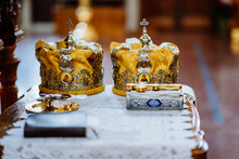 Crowns On Lectern. A High Table With A Sloping Top For Liturgical Books