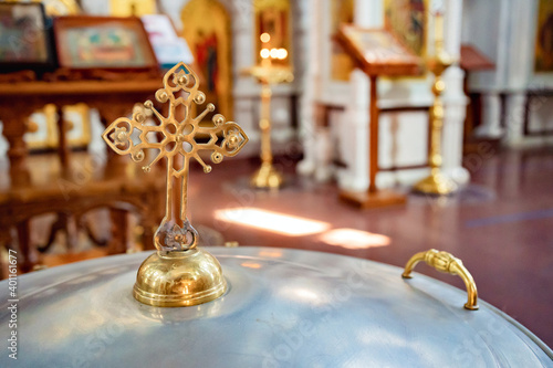 cover of the baptismal font in the Orthodox Church with a handle Fototapet