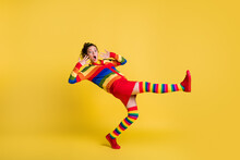 Profile Photo Of Shocked Lady Felling Down Slippery Floor Wear Striped Sweater Short Skirt Knee Socks Shoes Isolated Yellow Color Background