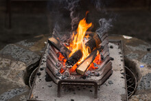 Small Open Wood Fire Burning In A Metal Grate