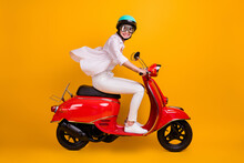 Side Profile Full Length Photo Of Charming Funny Student Lady Riding Motorbike Wind Face Fast Trip Wear White Striped Shirt Pants Helmet Glasses Isolated Yellow Vivid Color Background