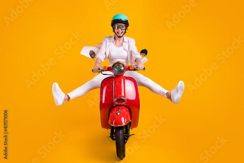 Full length photo of shocked crazy girl biker ride motor bike impressed fast spe Fotobehang