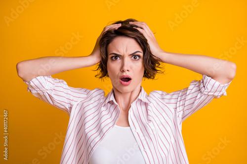 Billede på lærred Photo of frustrated shocked girl hear horrible fail mistake novelty impressed to