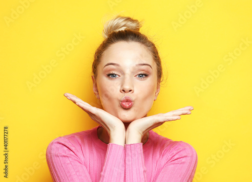 Beautiful blond woman with kiss gesture Wallpaper Mural