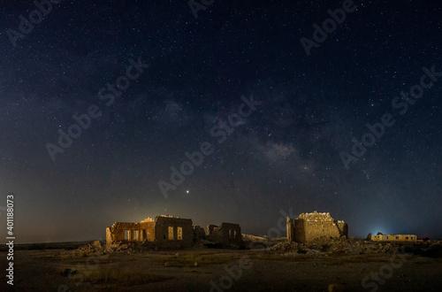Obraz Old village ruins under Milky Way - fototapety do salonu