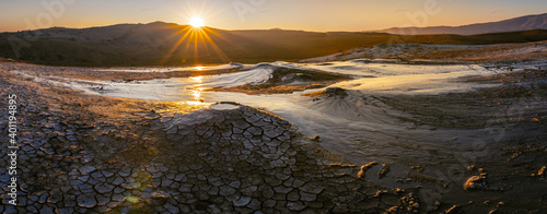 Fotografie, Obraz wide panoramic view of Mud volcanoes with stunning sunrise in Chahuna managed reserve in Georgia