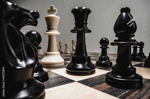 Chess figures on chess board macro photo Fototapet