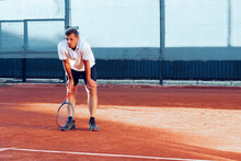Man Tennis Player Gets Tired During His Training