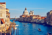 """The View On The сathedral Of """"Santa Maria Della Salute"""" From The Bridge Of """"Ponte Dell'Accademia"""" Throw The Grand Canal In The City Of Venice"""