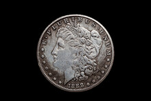 USA One Dollar Morgan Silver Coin Replica Dated 1880 With A Portrait Image Of Liberty On The Obverse Cut Out And Isolated On A Black Background, Stock Photo Image