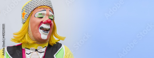 Fotografie, Obraz happy clown isolated portrait latin american joyful performing and smiling with