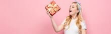 Happy Blonde Young Pregnant Woman With Gift Box On Pink Background, Banner.
