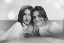 Warm. Portrait Of Beautiful Brunette Women In Comfortable Soft Longsleeves On Studio Background, Black And White. Home Comfort, Emotions, Facial Expression, Winter Mood Concept. Friendship.