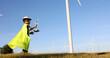 Leinwandbild Motiv Asian little boy wants to be an engineer the wind turbines, Child's dream of environmental engineering renewable energy concept