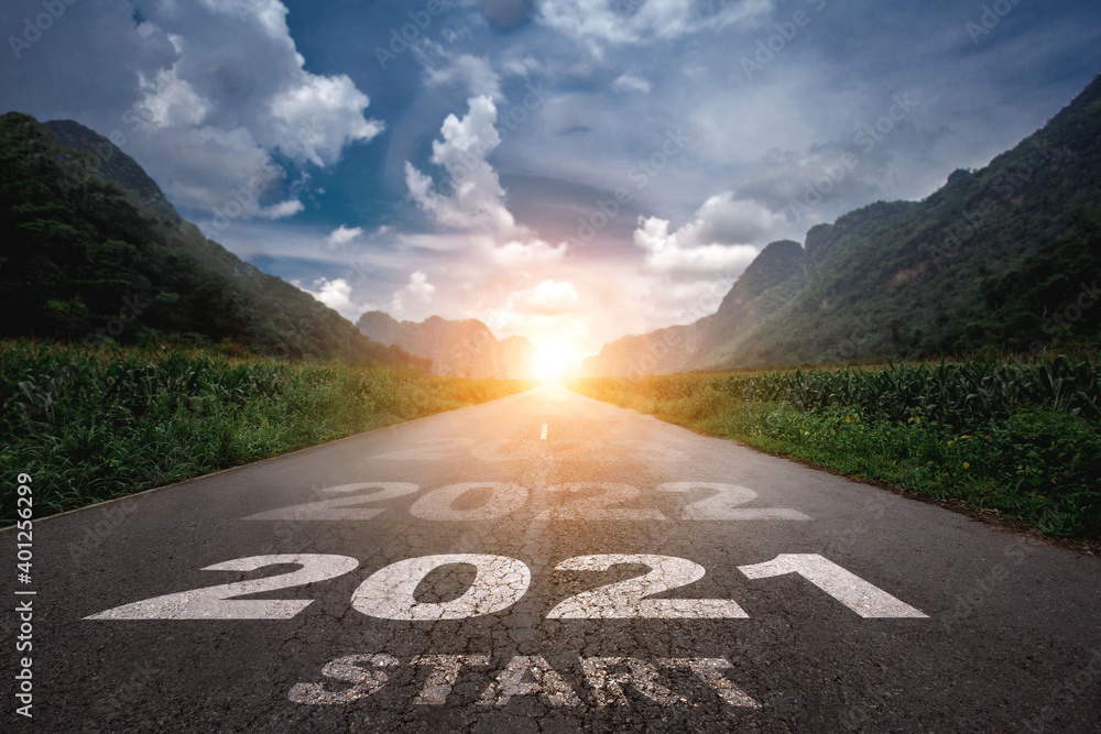 Fototapeta 2021, The New Year 2021 or the beginning of the concept of the word 2021 is written on the road in the middle of the asphalt road with a sunset mountain backdrop, concepts of planning and challenges