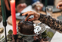 Unrecognizable Person With Piece Of Delicious Chocolate Cake Standing At Table During Christmas Celebration At Home